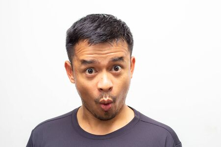 Portrait of amazing facial expression asian men face on white background, Wow men face Foto de archivo