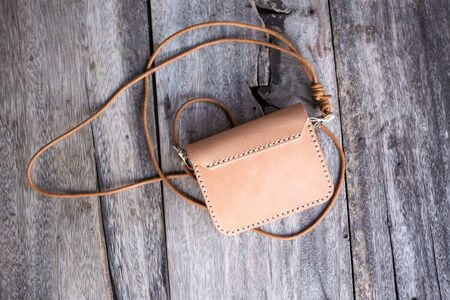 Vegetable tanned leather purse bag waist belt pocket on wood handmade bag