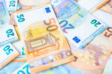 Background of 20 and 50 value Euro money bill close up finance concept