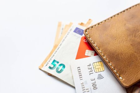 Euro money with credit card on white background business finance