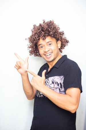 Smart funny afro hair men posting hand sign on white background business concept Stock fotó