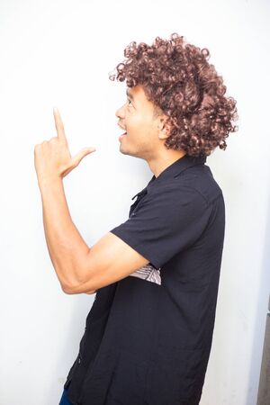 Smart funny afro hair men posting hand sign on white background business concept