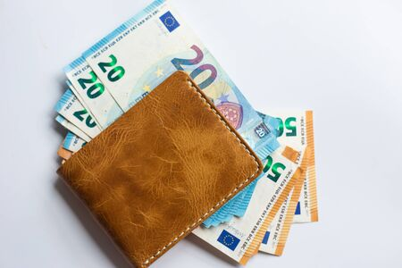 Euro money in leather wallet business finance on white background