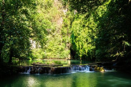 Waterfall in deep tropical rainforest with green tree nature landscape in Phangnga Thailand