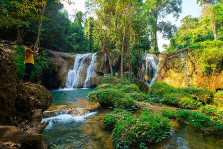 Beautiful waterfall with emerald pool water slope in tropical  rainforest Thansawan waterfall Phayao, Thailand