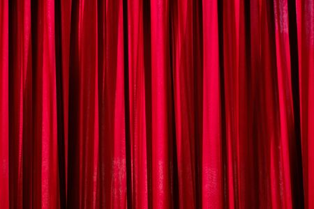 Luxury red closed curtain with light spots in a theater, Red curtain Archivio Fotografico