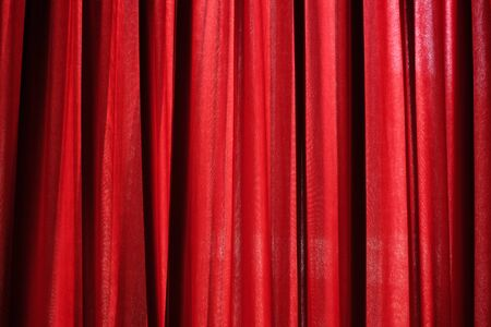 Luxury red closed curtain with light spots in a theater, Red curtain