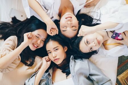 Fashion beautiful women group meeting on bed celebration concept