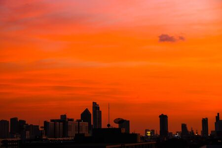 Silhouette city building sunset colorful sky with cloud sunset backgroud