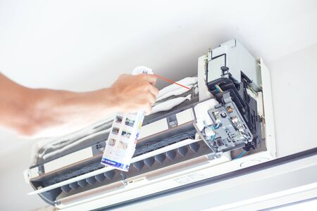 Aircondition self service maintenance fixing AC unit and foam cleaning the dusk filters.