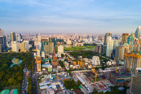 Bangkok downtown city office building with green park sunset aerial view Thailand Editorial