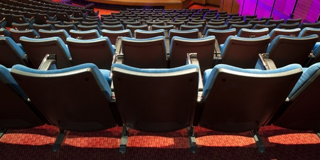 bleachers: rows of chairs in a theater Conference room
