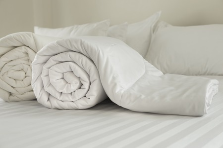 Duvet roll  down filled duvet rolled up isolated on white background Stok Fotoğraf