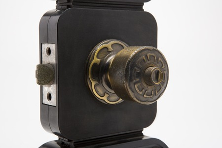 Aluminium door knob on the black door white background. photo