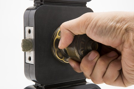 hand hold an Aluminium door knob on the black door white background. photo