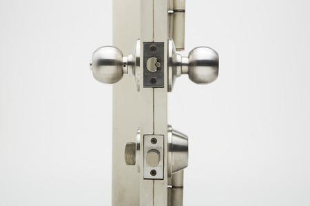Door knobs, aluminum door white background. Standard-Bild