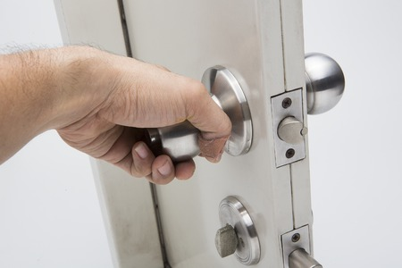 Door knobs, aluminum door white background. Banque d'images