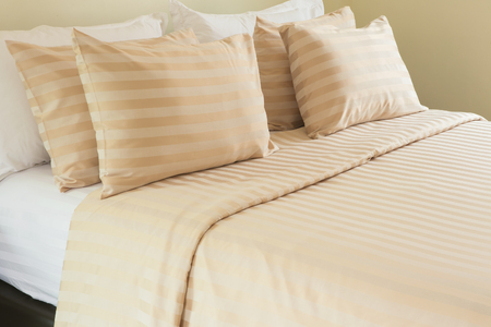 bedchamber: White pillows on a bed Comfortable soft pillows on the bed Stock Photo
