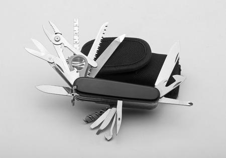 multifunction: Knife multi-tool, isolated on white background Stock Photo