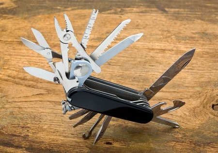 Knife multi-tool, isolated on white background Archivio Fotografico