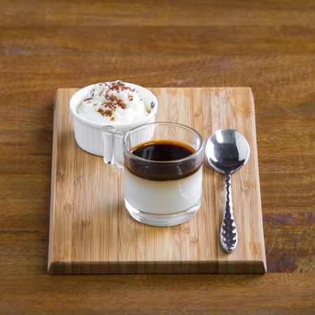 homely: Delicious baked egg custard, topped with nutmeg. A healthy, homely dessert. Stock Photo