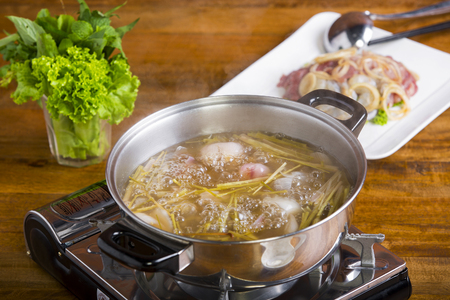 appetize: Vietnamese Traditional Food: hotpot with seafood ( shrimp, squid, fish) and vegetable with special soup called Lau Mam
