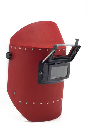 Welding mask and gloves on a white background. photo