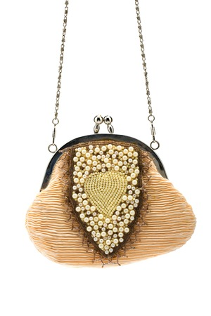 jewlery: Fashionable handbag with pearls on white background.