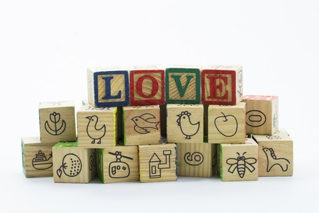 child s block: Wooden toy blocks spelling I love you isolated on a white background