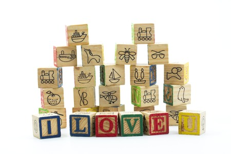 straightforward: Wooden toy blocks spelling I love you isolated on a white background