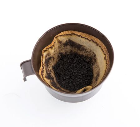 exempted female: Black coffee and coffee filters, coffee with white background.
