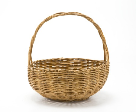 Empty wicker basket isolated on white Фото со стока