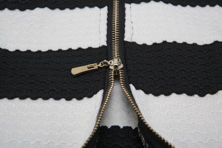 undressing: zipper in the black cloth and white