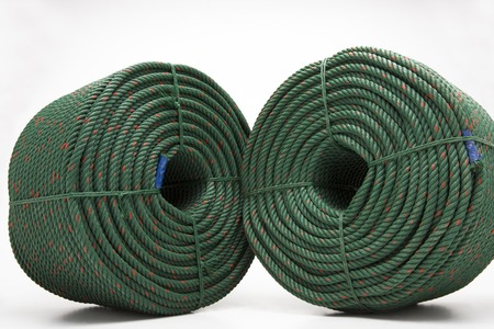 corded: large roll with new green rope for the shipping industry Stock Photo