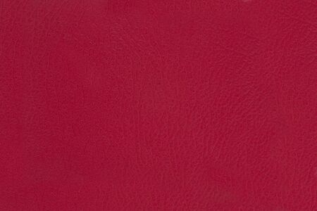 leatherette: red leatherette texture as background. Stock Photo