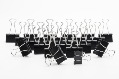 foldback: Black Paper clip isolated on white background.