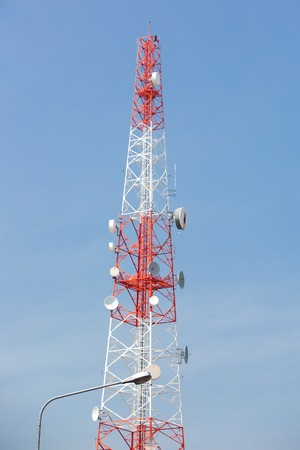 Telecommunication mast TV antennas wireless technology with blue sky