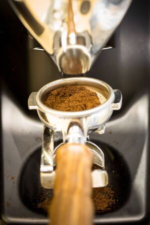 Professional coffee mill machine for making espresso in a cafe.
