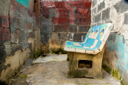 furniture design: Old cement chair in a brick room