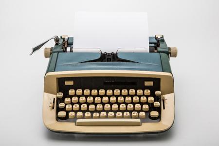Old typewriter on white background