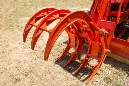 Modern tractor on modern agricultural machinery. Stock Photo