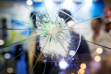 Broken glass on a people background Stock Photo