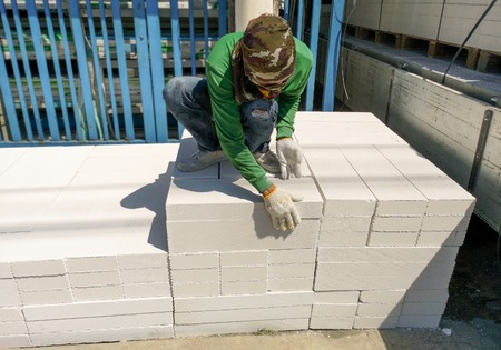 White rectangular bricks, including decorative brick on an outdoor pallet.