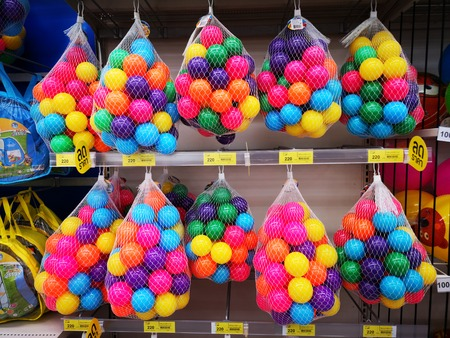 Children play colorful plastic balls in the net. Stok Fotoğraf