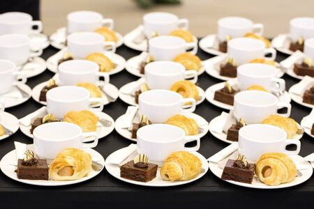 Coffee and delicious desserts on the buffet in the hotel