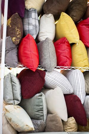 Colorful pillows placed on the floor for sale 写真素材