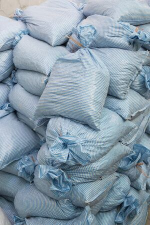 Sand bags help keep flood waters out of a town Process Stock Photo