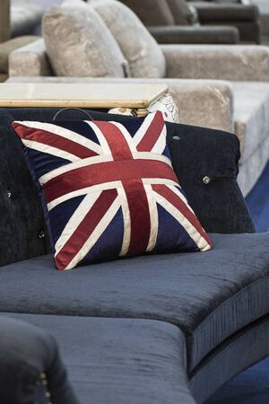 The American flag pillows on the sofa