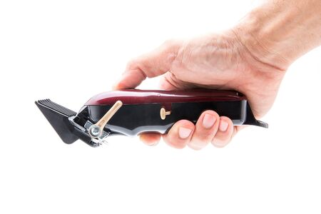 Hair clippers in the hands on a white background