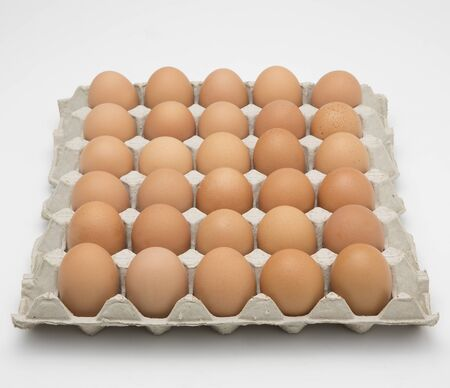 Eggs in paper tray isolated on white 版權商用圖片